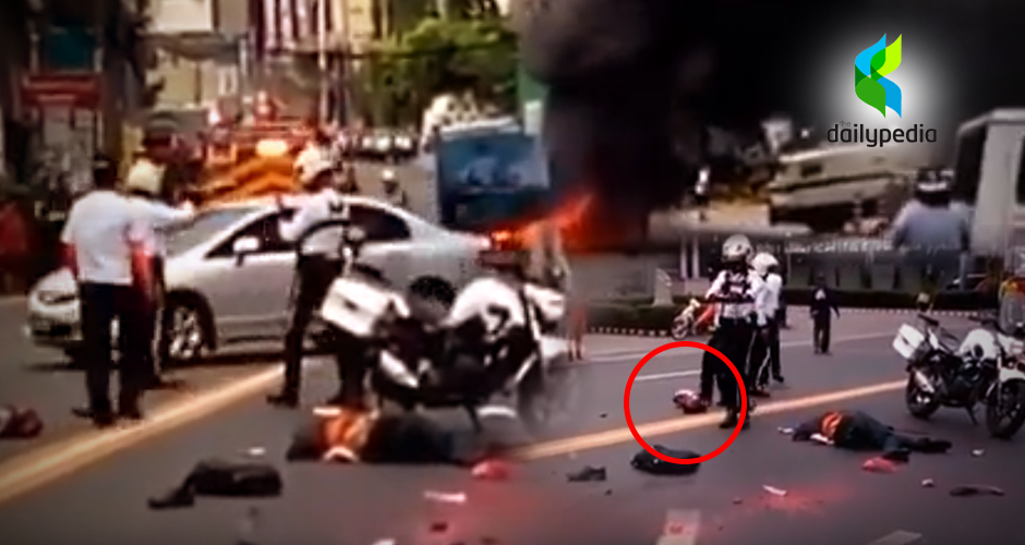 Traffic Enforcer Kicks The Severed Head Of A Road Accident