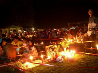 Families spending the night with their loved one in cemeteries.
