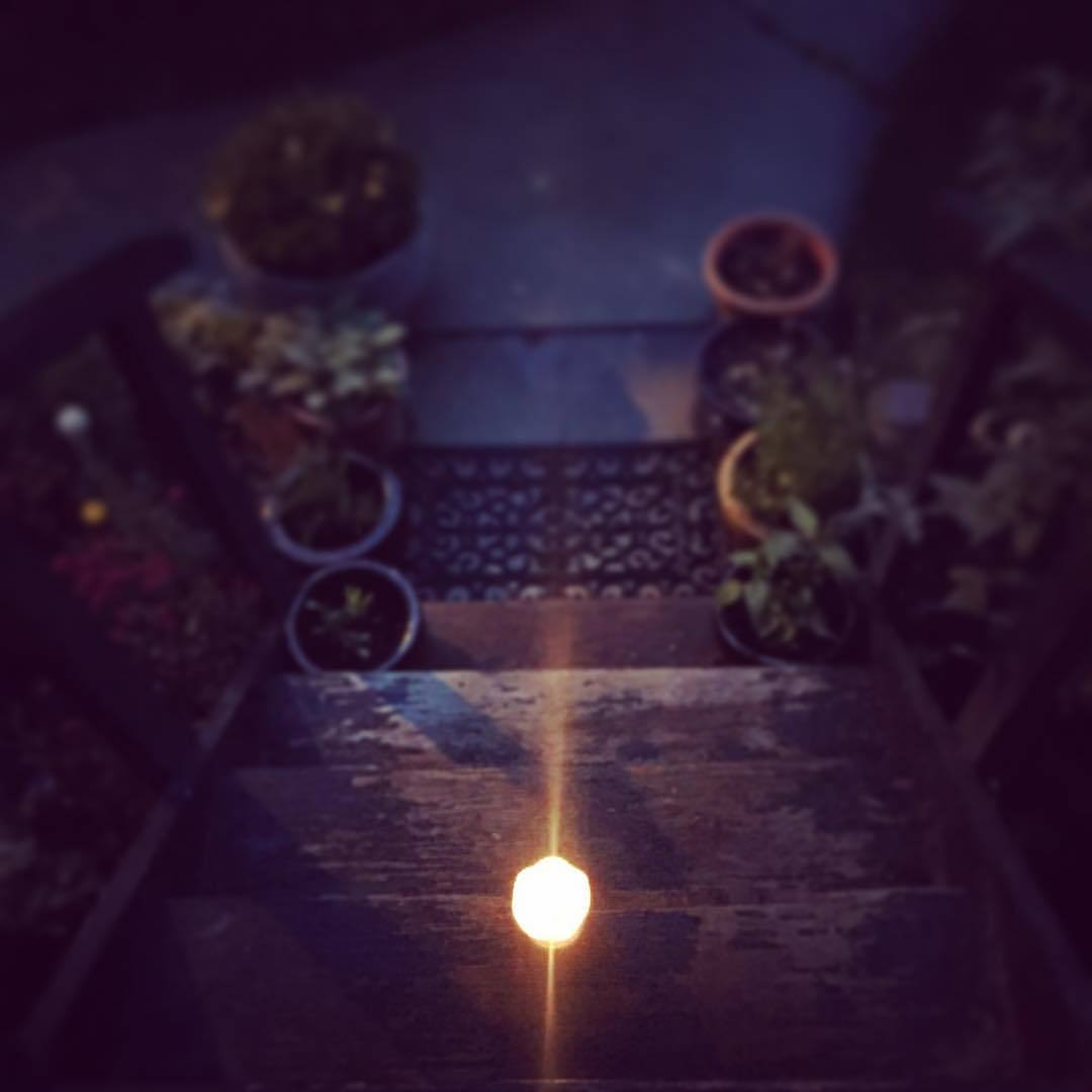 A candle on the doorstep is to help souls have a brighter journey.